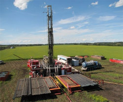 A Rock Drill Sales oil drilling rig in an oil field.