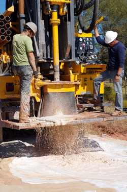 Water well drilling with Rock Drill Sales' Atlas Copco drilling equipment.